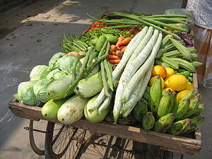 English: Variety of fresh vegetables being sol...